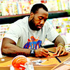 WARREN DILLAWAY / Star Beacon<br /> JAMES-MICHAEL JOHNSON, a Cleveland Browns linebacker, signs autographs Friday evneing at Giant Eagle in Saybrook Township.