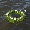 WARREN DILLAWAY / Star Beacon<br /> A MEMORIAL wreath floats in the Ashtabula River on Saturday night after it was thrown by Rae Ann Benedict during the 64th Annual Blessing of the Fleet ceremony.