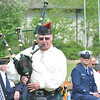 GARY QUINE plays the bagpipes during an Armed Forces Day event.