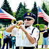 """H.D. """"MARTY"""" MARTINEZ opens an Echo Taps during an Armed Forces service at Greenlawn Memory Gardens in North Kingsville Saturday morning."""