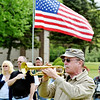 CHUCK CLARK plays Taps during an Armed Forces service at Greenlawn Memory Gardens in North Kingsville Saturday morning.
