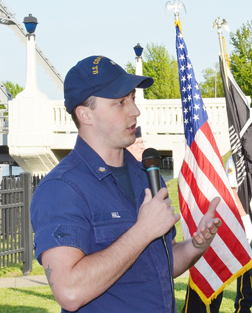 WARREN DILLAWAY / Star Beacon<br /> STEVE HALL, a U.S. Coast Guard petty officer third class, greets the crowd during the 64th Annual Blessing of the Fleet Ceremony in Ashtabula Harbor Saturday night.