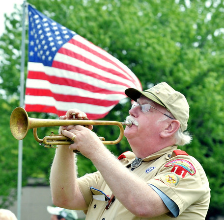 ALLAN RICHARDS plays Taps during an Armed Forces service at Greenlawn Memory Gardens in North Kingsville Saturday morning.