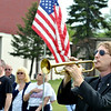 JUSTIN THOMPSON plays Taps during an Armed Forces service at Greenlawn Memory Gardens in North Kingsville Saturday morning.