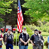 MEMBERS OF Guardians USA Vets listen during an Echo Taps program at Greenlawn Memory Gardens in North Kingsville.