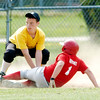WARREN DILLAWAY / Star Beacon<br /> MICHAEL KLUGH (facing) of the Kingsville Junior League team applies a late tag to Jacob Bryant of Ashtabula on Saturday at Kingsville.