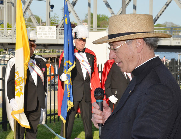 WARREN DILLAWAY / Star Beacon<br /> REV. RAYMOND THOMAS bows his head in prayer during the 64th Annual Blessing of the Fleet ceremony sponsored by Our Lady of Peace Parish.