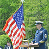 """DONALD """"MARTY"""" BURNHAM, a chief electronics technician with the United States Coast Guard, was the main speaker Saturday at Greenlawn Memory Gardens during an Armed Forces event."""