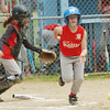 WARREN DILLAWAY / Star Beacon<br /> RILEY WILBER of the Madison Minor League team dashes to first base as Rosslyn Campbell (back left) of Ashtabula dashes for a bunt Saturday at Cederquist Park in Ashtabula.