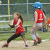 WARREN DILLAWAY / Star Beacon<br /> LEXI LEMAN of Ashtabula catches the ball as Riley Wilber of Madison arrives at third base during Minor League softball action at Cederquist Park in Ashtabula Saturday.