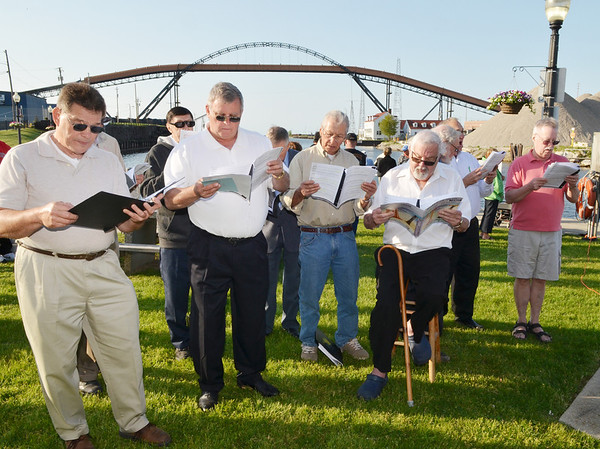 WARREN DILLAWAY / Star Beacon<br /> MEMBERS OF the Mother of Sorrows Men's Choir, sing during the 64th Annual Blessing of the Fleet ceremony in Ashtabula Harbor Saturday evening.