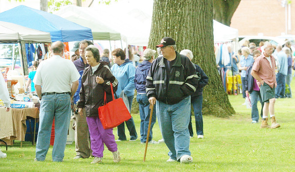 WARREN DILLAWAY / Star Beacon<br /> HUNDREDS OF people attended  the Kingsville Lawn Sale o Saturday on the village green. The event is a fundraiser for the Kingsville Public Library and has been held for the last 39 years.