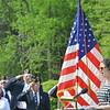WARREN DILLAWAY / Star Beacon<br /> EMILY KLINE sings the Star Spangled Banner on Saturday durig an Echo Taps program at Greenlawn Memory Gardens.