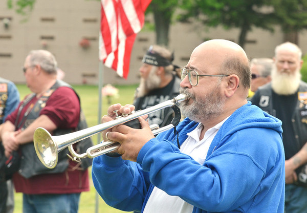 RICHRARD SESCO plays Taps during an Armed Forces service at Greenlawn Memory Gardens in North Kingsville Saturday morning.