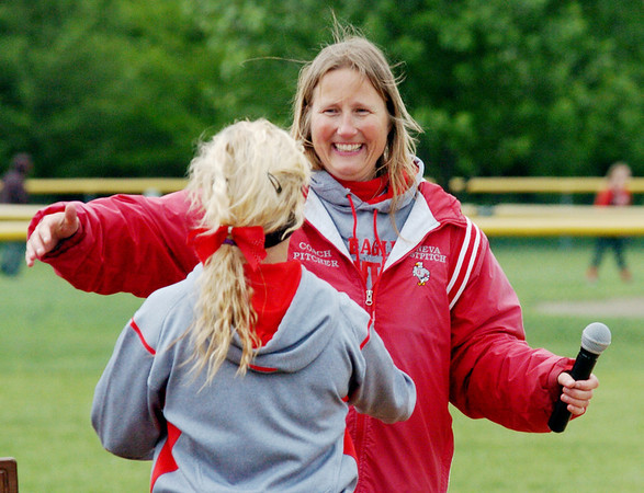 WARREN DILLAWAY / Star Beacon<br /> ELEISHA PITCHER, Geneva softball coach, prepares to hug second baseman Jamie Verno after the Eagles defeated Notre Dame Cathedral Latin to win the Division II district championship at the Jefferson Area Girls Softball complex Friday afternoon.