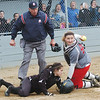 WARREN DILLAWAY / Star Beacon<br /> NICOLE GRIMMITT of Geneva (right) holds the ball after umpire Rick Nemet called  Camille Pollutro of Notre Dame Cathedral Latin safe at home plate on Friday afternoon during the Division II district championship game at the Jefferson Area Girls softball complex.