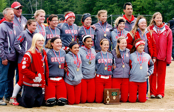 WARREN DILLAWAY / Star Beacon<br /> THE GENEVA girls softball team and coaching staff pose for pictures after defeating Notre Dame Cathedral Latin on Friday afternoon at the Jefferson Area Girls softball complex.