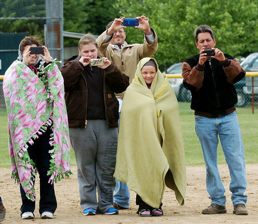 WARREN DILLAWAY / Star Beacon<br /> GENEVA SOFTBALL fans take pictures after the Eagles defeated Notre Dame Cathedral Latin to win the Division II district championship on Friday afternoon at the Jefferson Area Girls softball complex.