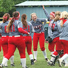 WARREN DILLAWAY / Star Beacon<br /> AMY PITCHER (1) of Geneva and Eagle teammate Sarah Depp (facing with hand in the air)) gather with teammates after winning the Division II district softball championshp at the Jefferson Area Girls softball complex.