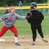 WARREN DILLAWAY / Star Beacon<br /> SARAH DEPP of Geneva (left) reaches for an errant throw as Cindy Carballada of Notre Dame Cathedral Latin arrives at second base on Friday afternoon during the Division II district championship game at the Jefferson Area Girls softball complex.