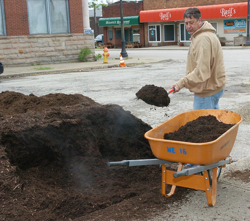 WARREN DILLAWAY / Star Beacon<br /> JIM FISHER, executive assistant to the warden at Lake Erie Correctional Institution, prepares to spread mulch during a public service project at the Port of Conneaut Marine Memorial Park Friday morning. About a dozen employees and family members worked to beautify the park.