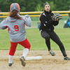 WARREN DILLAWAY / Star Beacon<br /> SARAH DEPP of Geneva (left) is forced at second base by Jenny Raguz of Notre Dame Cathedral Latinon Friday afternoon during the Division II district championship game at the Jefferson Area Girls softball complex.