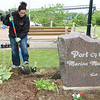 WARREN DILLAWAY / Star Beacon<br /> JENNIFER MAKI, an administrative clerk at Lake Erie Correctional Institution, (facing) plants flowers during a public service project at the Port of Conneaut Marine Memorial Park Friday morning. About a dozen employees and family members worked to beautify the park.