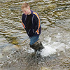 WARREN DILLAWAY / Star Beacon<br /> JACOB DIBELL, a fifth grader at Erie Intermediate School, looks for living creatures in the Ashtabula River during the  After School Discovery Waterways Adventures Outdoor Learning Day.