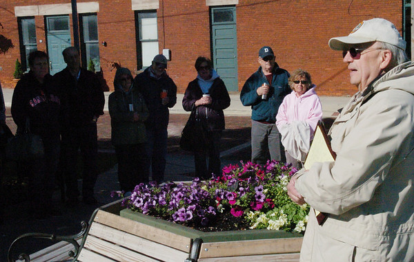 WARREN DILLAWAY / Star Beacon<br /> BRAND NEW bike racks along Bridge Street were one of the many blessings the Ashtabula Liftbridge Association celebrated Saturday morning during a Blessing of the Bridge ceremony led by the Rev. Glen Warner. Participants in the ceremony posed for a picture after the blessing.