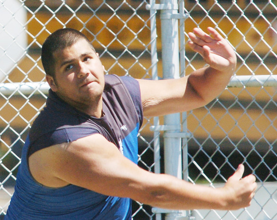 WARREN DILLAWAY / Star Beacon<br /> ALEX OSCAR of Grand Valley follows through on a discus throw on his way to a third place finish at the Perry District A Track Meet on Saturday.