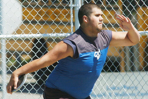 WARREN DILLAWAY / Star Beacon<br /> ALEX OSCAR of Grand Valley got third in the Division II Perry District A discus championship earning a spot at the Bedford regional meet next week.