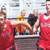 WARREN DILLAWAY / Star Beacon<br /> JACOB HAMILTON (left) receives the baton from Jefferson teammate Jon Simon on Saturday during the 4 x 200 meter relay at the Division II Perry District B Track Meet.