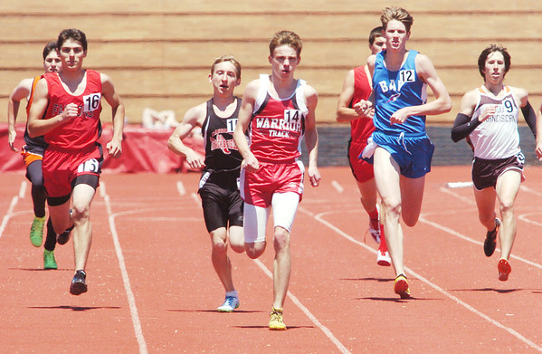 WARREN DILLAWAY / Star Beacon<br /> BRADON KLUGE (14) of Edgewood leads a group of runners on Saturday during the early stages of the 800 meter run at the Division II Perry B Track Meet. He narrowly missed a spot at the Bedford Regional meet with a fifth place finish.