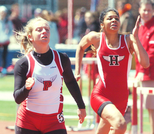WARREN DILLAWAY / Star Beacon<br /> DANA CROFOOT (left) of Perry beat Hannah Britton of Harvey to the finish line Saturday during the 100 meter run at the Division II District A Track Meet at Perry. Crofoot will be competing next week at the regional meet in Bedford.