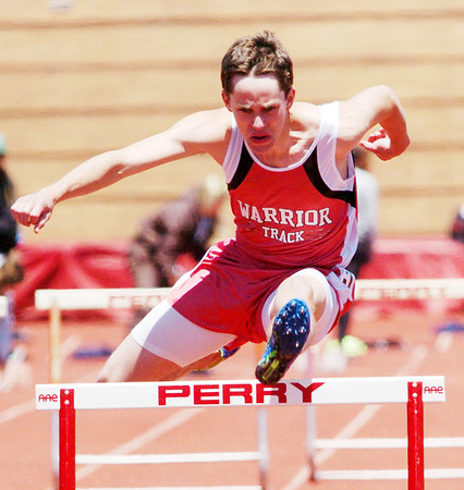 WARREN DILLAWAY / Star Beco<br /> IAN LYNCH of Edgewood clears the last hurdle of the 110 meter hurdles on Saturday during the Division II Perry B Track Meet.