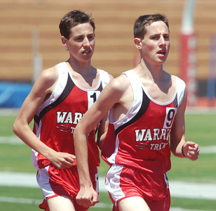 WARREN DILLAWAY / Star Beaco CHRIS LEMAY (9) and his Edgewood teammate and twin brother Josh battle it out in the 3200 meter run on Saturday during the Division II Perry District B Track Meet.