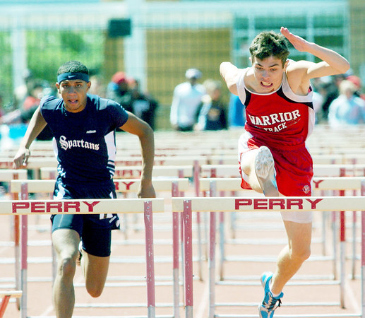 WARREN DILLAWAY / Star Beacon<br /> IAN LYNCH (right) of Edgewood and Levi Stewart of Conneaut battle it out in the 110 meter hurdles on Saturday at the Perry District B Track Meet.