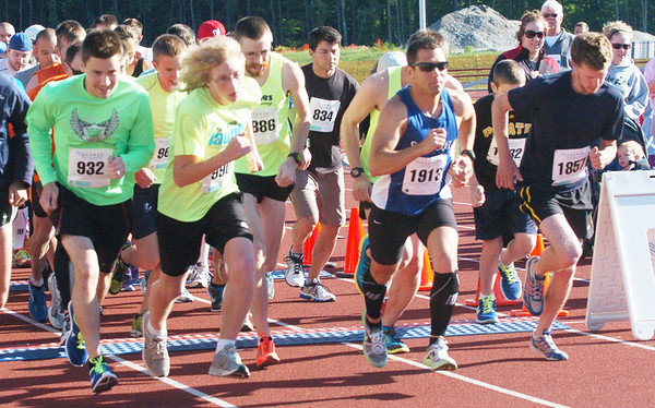WARREN DILLAWAY / Star Beacon<br /> DAN WHISLER (1857) breaks from the starting line of the 1st Lt. Michael L. Runyan 5k Run and Walk on Sunday at Spire Institute. Whisler won the race in honor of his high school friend who died while serving his country in Iraq in 2010.