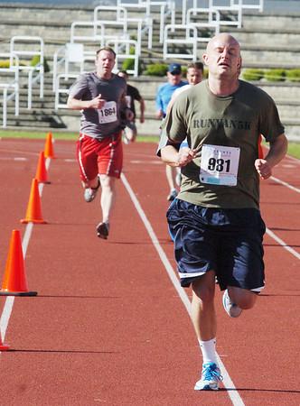 WARREN DILLAWAY / Star Beacon<br /> SCOTT RUNYAN (981) finishes the 1st Lt. Michael L. Runyan 5k Run and Walk on Sunday at Spire Institute in Harpersfield Township.