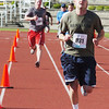 WARREN DILLAWAY / Star Beacon<br /> SCOTT RUNYAN (981) finishes the 1st Lt. Michael L. Runyan 5k Run and Walk on Sunday at Spire Institute in Harpersfield Township.