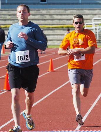 WARREN DILLAWAY / Star Beacpm<br /> SHANE POPKE (left) of Washington, Utah, and Jesse Sharp of Ashtabula, prepare to cross the finish line of the 1st Lt. Michael L. Runyan 5k Run and Walk on Sunday at Spire Institute in Harpersfield Township.