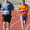 WARREN DILLAWAY / Star Beacpm<br /> SHANE POPKE (left) of Washington, Utah, and Jesse Sharp of Ashtabula, prepare to cross the finish line of the 1st Lt. Michael L. Runyan 5k Run and Walk on Sunday at Spire Institute in Harpersfield Township.