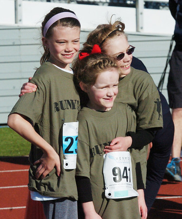 WARREN DILLAWAY / Star Beacon<br /> MAGGIE MOON, 6, (941) and her sister Grace (with glasses), 9, both of Geneva, pose for a picture with cousin Brook Moon, 8, of Stow, Sunday prior to the 1st Lt. Michael L. Runyan 5k Run and Walk at Spire Institute in Harpersfield Township.