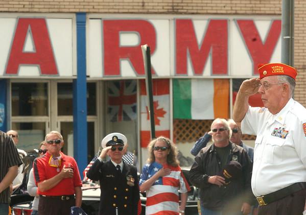 WARREN DILLAWAY / Star Beacon<br /> THE REV. Robert Leonard, commander of the Frank Kalinowski Marine Corps League 782 (right) salutes during a Memorial Day service in downtown Ashtabula.