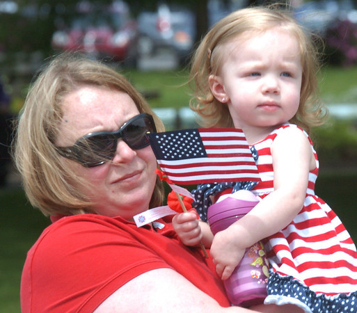 WARREN DILLAWAY / Star Beacon<br /> MANDY SMITH holds her daughter Victoria Smith, 2, both of Ashtabula, during the Ashtabula Memorial Day parade on Monday.