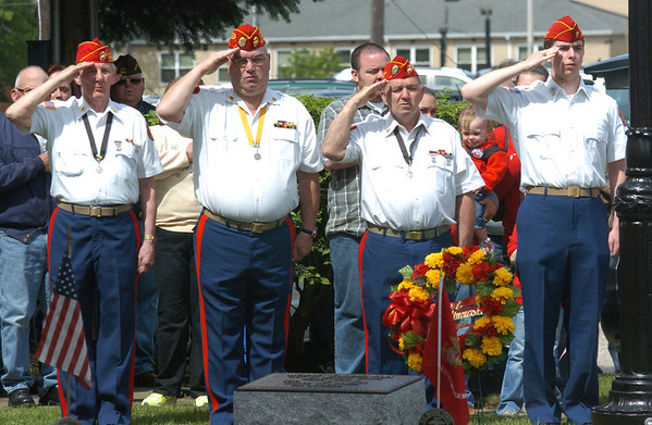 WARREN DILLAWAY / Star Beacon<br /> MEMBERS OF the Frank Kalinowski Marine Corps League 782 salute during a Memorial Day service Monday in dowtown Ashtabula.
