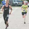 WARREN DILLAWAY / Star Beacon<br /> MEGAN ALBERT (left) and Diedre Fleming sprint to the finish of the Memorial Day Lift Bridge 5K Monday in Ashtabula.