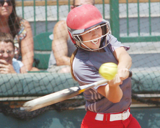 WARREN DILLAWAY / Star Beacon<br /> BECKY DEPP of Geneva takes a mighty swing on Thursday during a Division II regional semi-final game at Firestone Park in Akron.