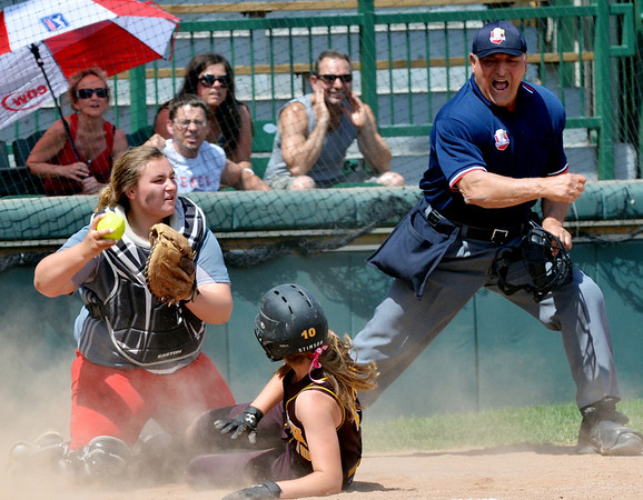 WARREN DILLAWAY / Star Beacon<br /> NICOLE GRIMMETT (left) of Geneva tags Taylor Stimson  of Walsh Jesuit out at the plate during a Division II regional semi-final game at Firestone Park in Akron on Thursday afternoon. Umpire Anthony Montana called Stimson out at the plate.