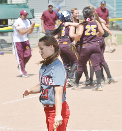 WARREN DILLAWAY / Star Beacon<br /> BECKY DEPP of Geneva reacts after striking out to end the game on Thursday during a Division II regional semi-final game at Firestone Park in Akron.